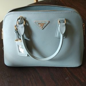 Prada Medium Leather Saffiano Handbag.